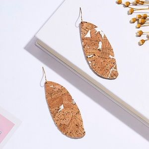 Brand new!!!! Cork/faux leather feather earrings